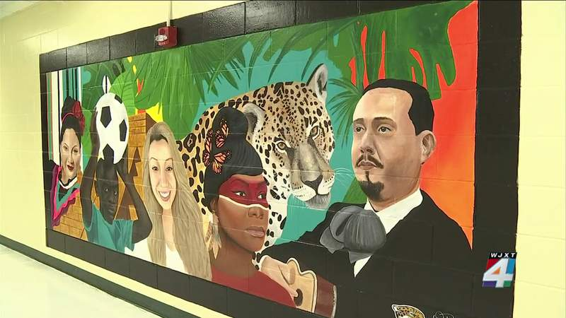 DuPont Middle School unveils mural in honor of Hispanic Heritage Month