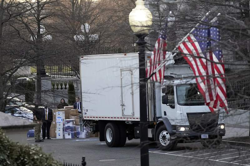 A van arrives to pick up boxes that were moved out of the Eisenhower Executive Office building, inside the White House complex, Thursday, Jan. 14, 2021, in Washington. Inauguration Day is also moving day at the White House. (AP Photo/Gerald Herbert)