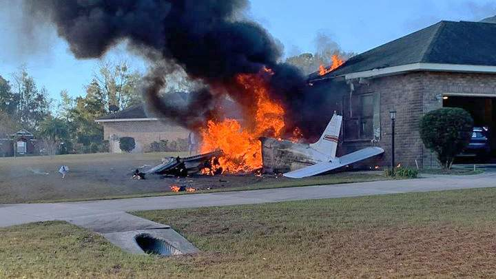 Neighbors rushed to help after a plane crashed and the fire spread to a nearby home.