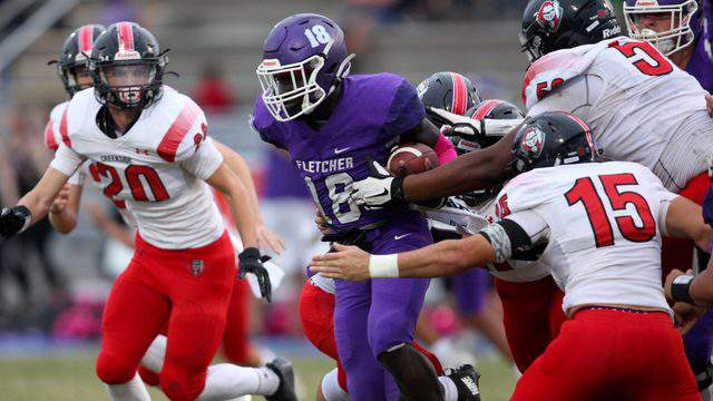 Fletcher running back Myles Montgomery evades the Creekside defense in the second quarter during Friday's game Montgomery rushed for 190 yards and scored three touchdowns in the Senators' 45-10 win. (Ralph D. Priddy, Contributed photo)