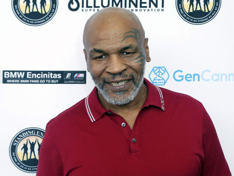 FILE - In this Aug. 2, 2019, file photo, Mike Tyson attends a celebrity golf tournament in Dana Point, Calif. Hulu on Thursday, Feb. 25, 2021, announced it has ordered Iron Mike, a limited series about the life of boxing great Mike Tyson. (Photo by Willy Sanjuan/Invision/AP, File)