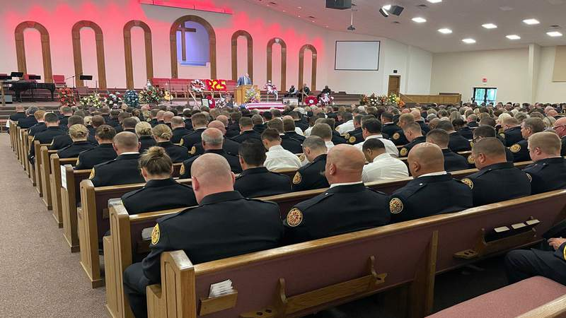 Firefighters fill Christian Fellowship Temple in Macclenny for the funeral of Capt. Thomas Barber.