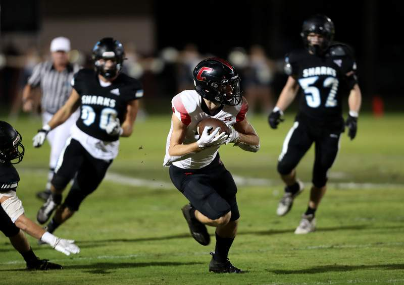 Creekside receiver Jake Goodrich, center, makes a catch and run in the first quarter during a Week 10 game at Ponte Vedra. (Ralph D. Priddy)