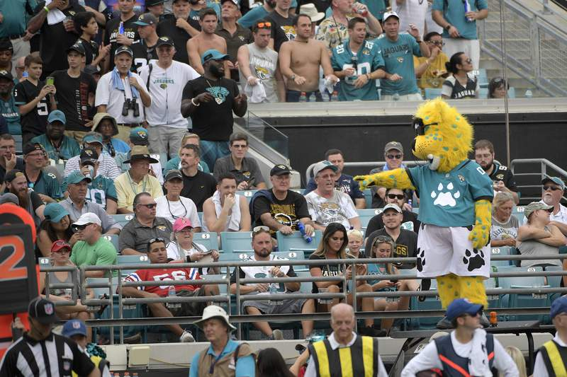 Jacksonville Jaguars mascot Jaxson de Ville entertains the fans in the stands during the second half of an NFL football game against the New England Patriots Sunday, Sept. 16, 2018, in Jacksonville, Fla. The Jaguars won 31-20. (AP Photo/Phelan M. Ebenhack)