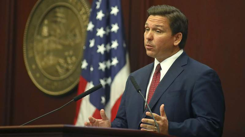 Gov. Ron DeSantis addresses a joint session of the Florida Legislature on Tuesday as the 2021 session opens.