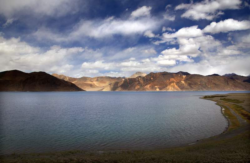 FILE- This Sept. 14, 2018 file photo shows Pangong Lake in Ladakh region, India. India and China accused each other Tuesday of making provocative military moves and firing warning shots along their disputed border despite talks to end the escalating tensions. China said Indian forces Monday crossed into territory it holds along the southern coast of Pangong Lake and fired warning shots at a Chinese patrol in what it called a violation of their agreements. India denied that and said the Chinese soldiers tried to surround one of their forward posts in a grave provocation and also fired few warning shots. (AP Photo/Manish Swarup, File)