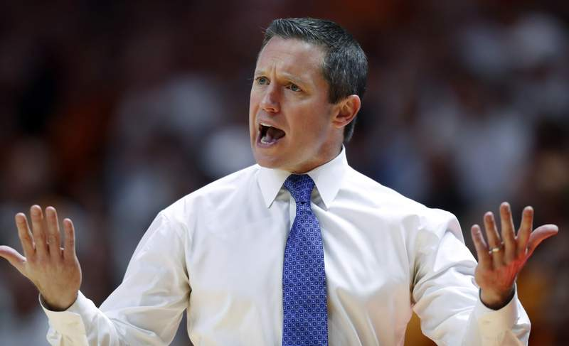 FILE - In this Feb. 9, 2019, file photo, Florida coach Mike White reacts to a call during the first half of an NCAA college basketball game against Tennessee, in Knoxville, Tenn. Florida coach Mike White spent the first three months of the season watching his Gators burn through just about any cushion they had in building a viable NCAA Tournament resume. Now his team could use a strong finish to earn a bid. (AP Photo/Wade Payne, File)