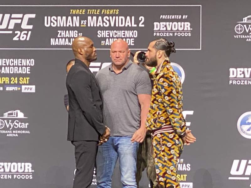 UFC president Dana White, center, stands between welterweights Kamaru Usman and Jorge Masvidal during a faceoff on Thursday. Those two headline Saturday's blockbuster pay-per-view card the VyStar Veterans Memorial Arena.