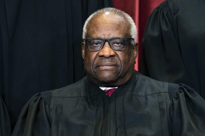 Associate Justice Clarence Thomas sits during a group photo at the Supreme Court in Washington, Friday, April 23, 2021. (Erin Schaff/The New York Times via AP, Pool)