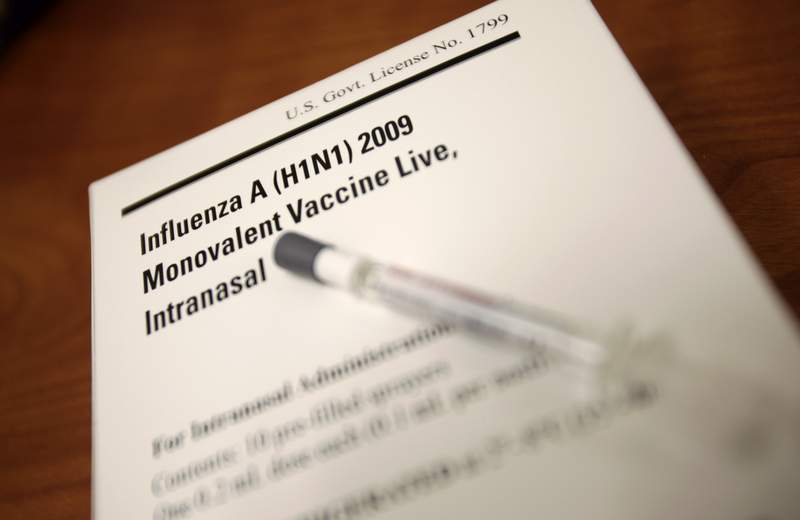 FILE - In this Nov. 9, 2009, file photo, a package of the H1N1 swine flu vaccine is shown at a pharmacy in Seattle. Last fall, as swine flu cases mounted and parents desperately sought to protect their kids, the hard-to-get vaccine was handed out in some surprising places: the Royal Caribbean cruise line, the headquarters of drug giant Merck, the Johnson Space Center, and a Department of Energy office in Idaho. (AP Photo/Ted S. Warren, file)