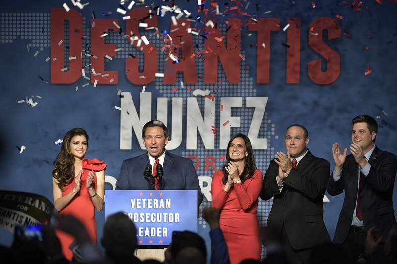 FILE - In this Nov. 6, 2018, file photo, Florida Gov.-elect Ron DeSantis, second from left, thanks supporters with his wife, Casey, left, Lt. Gov.-elect Jeanette Nunez, center; her husband, Adrian Nunez, second from right, and Rep. Matt Gaetz, R-Fla., after being declared the winner of the Florida gubernatorial race at an election party in Orlando, Fla. (AP Photo/Phelan M. Ebenhack, File)