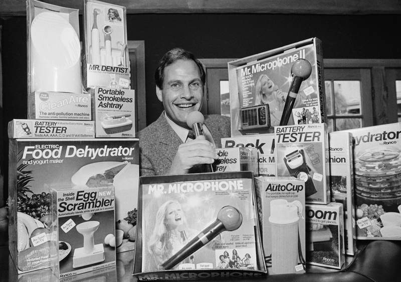 FILE - In this Wednesday, Dec. 8, 1982 record  photo, Ron Popeil, the antheral   down  those late-night, rapid-fire tv  commercials that merchantability   everything from the Mr. Microphone to the Pocket Fisherman to the classical  Veg-a-Matic, sits surrounded by his wares successful  his bureau   successful  Beverly Hills, Calif.  Ron Popeil, the quintessential TV pitchman and inventor known to generations of viewers for hawking products including the Veg-O-Matic, the Chop-O-Matic, Mr. Microphone and the Showtime Rotisserie and BBQ, died Wednesday, July 28, 2021 his household  said. (AP Photo/Reed Saxon, File)