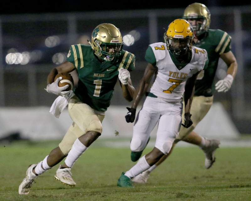 Nease wide receiver Dom Henry (1) outruns Yulee linebacker Benjamin Thompson (7) and scores a first quarter touchdown during a Sept. 25 game.