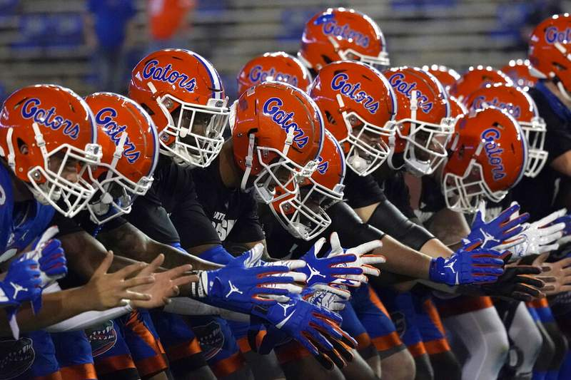 FILE - In this Dec. 12, 2020, file photo, Florida players get ready before an NCAA college football game in Gainesville, Fla. (AP Photo/John Raoux, File)