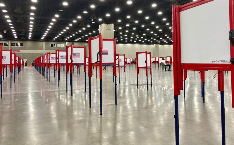 Voting stations are set up for the primary election at the Kentucky Exposition Center, Monday, June 22, 2020, in Louisville, Ky. With one polling place designated for Louisville on Tuesday, voters who didnt cast mail-in ballots could potentially face long lines in Kentuckys unprecedented primary election.  (AP Photo/Piper Blackburn)