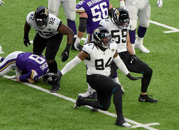 Dawuane Smoot of the Jacksonville Jaguars celebrates his sack of Kirk Cousins of the Minnesota Vikings withe teammate Aaron Lynch in the first half at U.S. Bank Stadium on December 06, 2020 in Minneapolis, Minnesota. (Photo by Stephen Maturen/Getty Images)