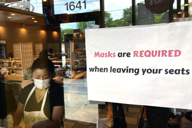FILE - In this June 17, 2021 file photo, a sign is displayed at a restaurant in Rolling Meadows, Ill. The Institute for Supply Management said Tuesday, July 6 growth in the services sector, where most Americans work, slowed in June following record expansion in May. (AP Photo/Nam Y. Huh, File)