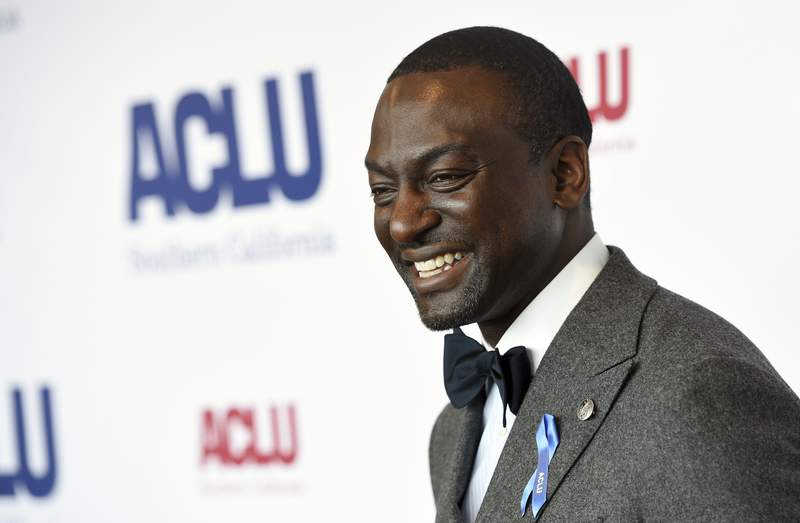 FILE - Honoree Yusef Salaam poses at the ACLU SoCal's 25th Annual Luncheon in Los Angeles on June 7, 2019. Salaam, one of the five teens wrongly imprisoned for the assault of a Central Park jogger, has a memoir coming out in the spring. Grand Central Publishing announced Monday that it had acquired Yusef Salaams Better, Not Bitter: Living On Purpose in The Pursuit of Racial Justice. (Photo by Chris Pizzello/Invision/AP, File)