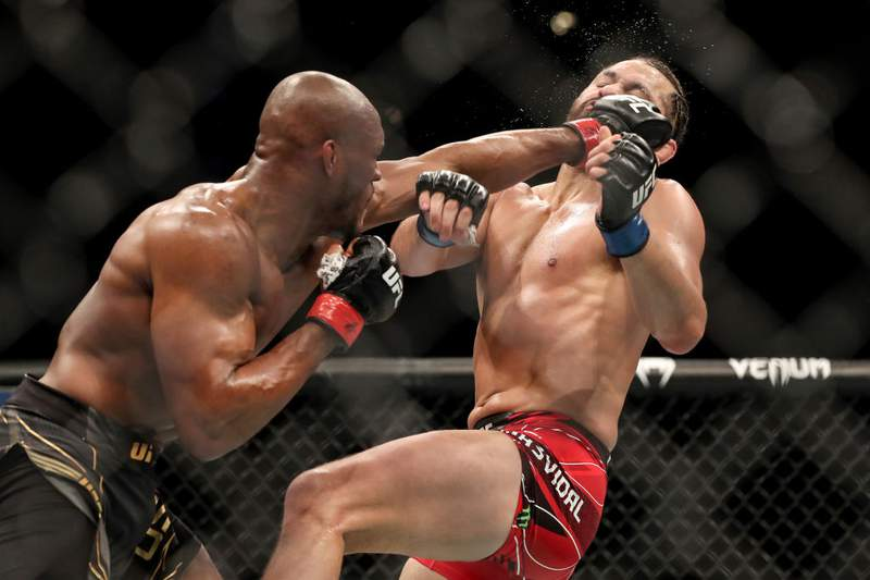 JACKSONVILLE, FL - APRIL 25: Kamaru Usman of Nigeria punches Jorge Masvidal of the United States during the Welterweight Title bout of UFC 261 at VyStar Veterans Memorial Arena on April 25, 2021 in Jacksonville, Florida.  (Photo by Alex Menendez/Getty Images)
