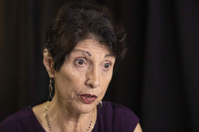 FILE - In this June 19, 2019, file photo, Diane Foley, mother of journalist James Foley, who was killed by the Islamic State terrorist group in a graphic video released online, speaks to the Associated Press during an interview in Washington. Family members of Americans who are imprisoned abroad or held hostage by militant groups say in a new report that the U.S. government must do better in communicating with them. The report from the James W. Foley Legacy Foundation is based on interviews with 25 former hostages and detainees as well as their relatives and advocates. (AP Photo/Manuel Balce Ceneta, File)