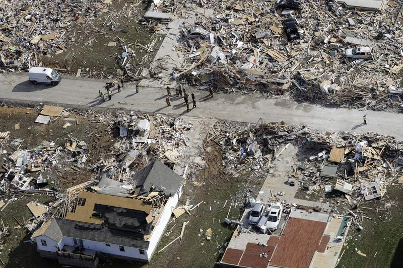 Emergency personnel work among destroyed homes Tuesday, March 3, 2020, near Cookeville, Tenn. Tornadoes ripped across Tennessee early Tuesday, shredding more than 140 buildings and burying people in piles of rubble and wrecked basements. At least 22 people were killed. (AP Photo/Mark Humphrey)