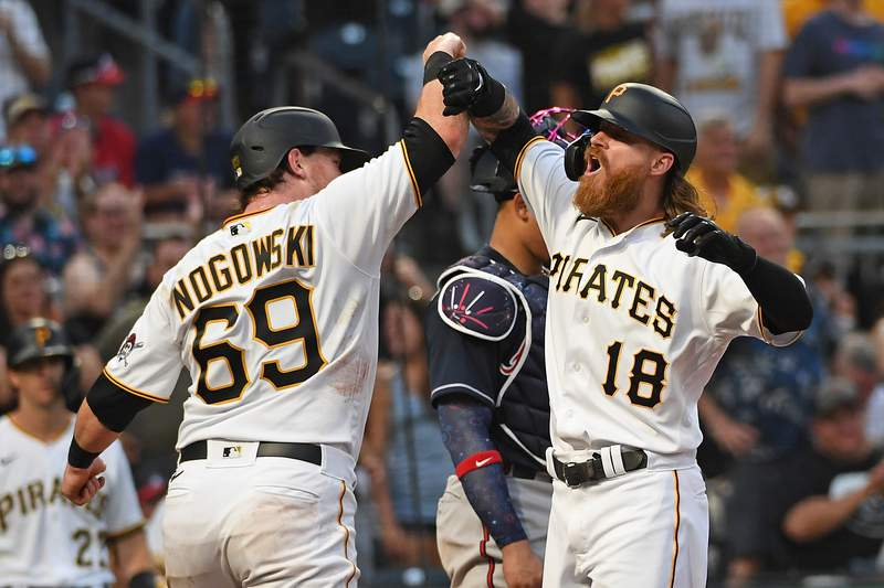Former Bishop Kenny star Ben Gamel (18) of the Pittsburgh Pirates celebrates with John Nogowski after hitting a two run home run in the fourth inning during the game against the Atlanta Braves at PNC Park on July 5, 2021 in Pittsburgh, Pennsylvania. (Photo by Justin Berl/Getty Images)