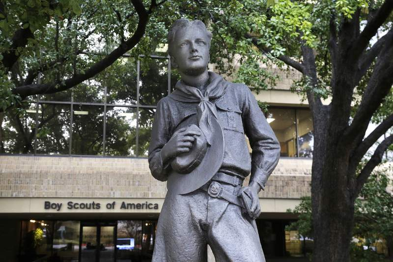 FILE - In this Feb. 12, 2020, file photo, a statue stands outside the Boy Scouts of America headquarters in Irving, Texas. One of the primary insurers of the Boy Scouts of America announced Tuesday, Sept. 14, 2021, that it has reached a tentative settlement agreement with the organization and with attorneys representing tens of thousands of men who say they were molested as youngsters decades ago by scoutmasters and others. (AP Photo/LM Otero, File)