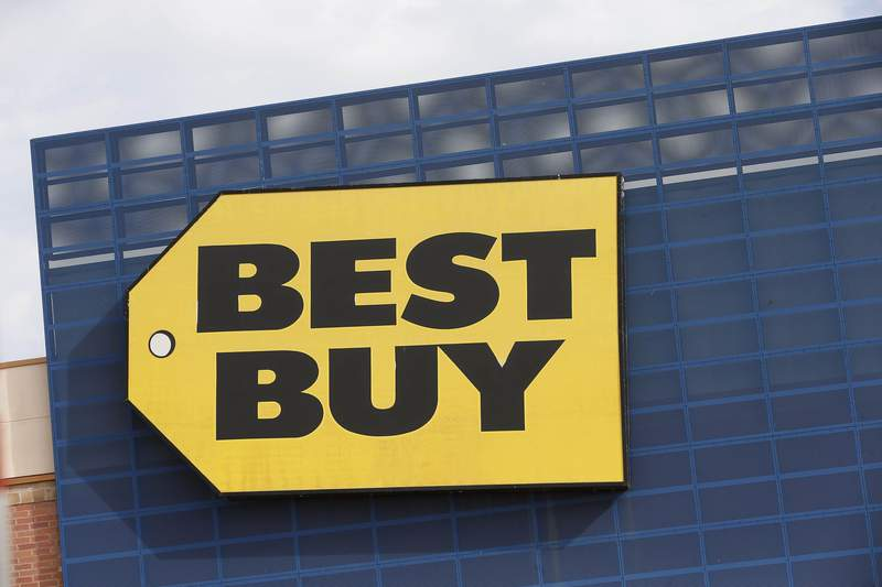 FILE - In this Aug. 27, 2019, file photo, the Best Buy logo is shown on a store in Richfield, Minn. Best Buy said it is investigating CEO Corie Barry after receiving an anonymous letter that made allegations against her. Best Buy declined to say what the allegations were. The Wall Street Journal, which first reported on the probe Friday, Jan. 17, 2020, said it saw the anonymous letter, which alleged that Barry had a relationship with another executive. (AP Photo/Jim Mone, File)
