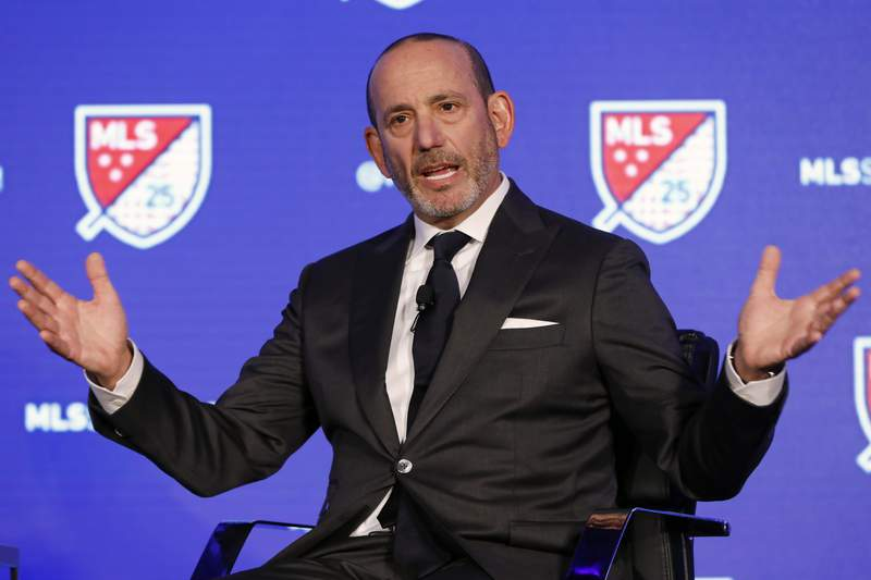 FILE - In this Feb. 26, 2020, file photo, Major League Soccer Commissioner Don Garber speaks during the leagues 25th Season kickoff event in New York. Garber said while Major League Soccer is on track to have losses nearing $1 billion because of the coronavirus, he's proud of how the league was able to navigate the pandemic and complete a difficult season. Garber gave his annual state of the league address on Tuesday, Dec. 8, 2020, in advance of the MLS Cup final on Saturday between the Seattle Sounders and Columbus Crew.(AP Photo/Richard Drew, File)