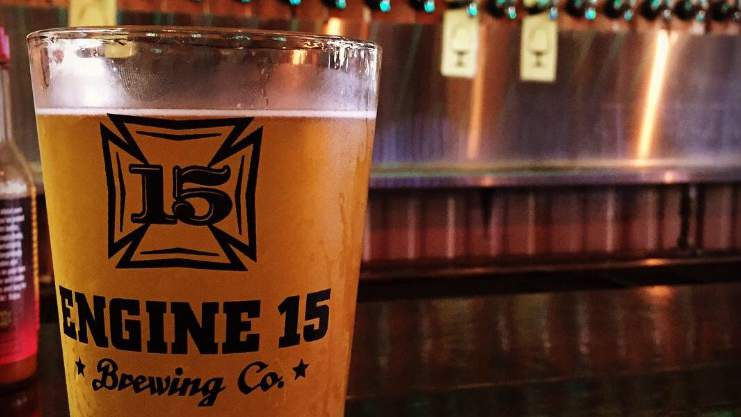 A pint sits on the bar at Engine 15.