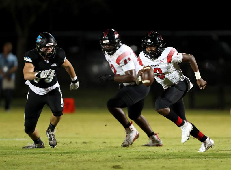 Creekside quarterback Daniel Plummer (3) is flushed from the pocket in the second quarter of Friday's game against Ponte Vedra. The Knights won 26-9. (Ralph D. Priddy)