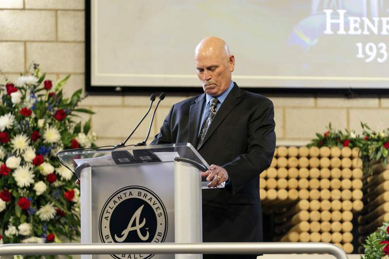 """Atlanta Braves Manager Brian Snitker takes a moment to collect himself while speaking during """"A Celebration of Henry Louis Aaron,"""" a memorial service celebrating the life and enduring legacy of the late Hall of Famer and American icon, on Tuesday, Jan. 26, 2021, at Truist Park in Atlanta. (Kevin D. Liles/Atlanta Braves via AP Pool)"""