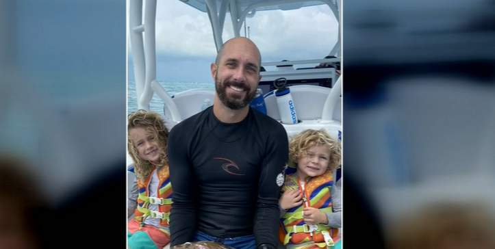 Timothy Obi, pictured here with two of his children, was diving and spearfishing with friends Saturday morning. The father of three and husband didn't resurface after submerging in 120 feet of water, loved ones said.