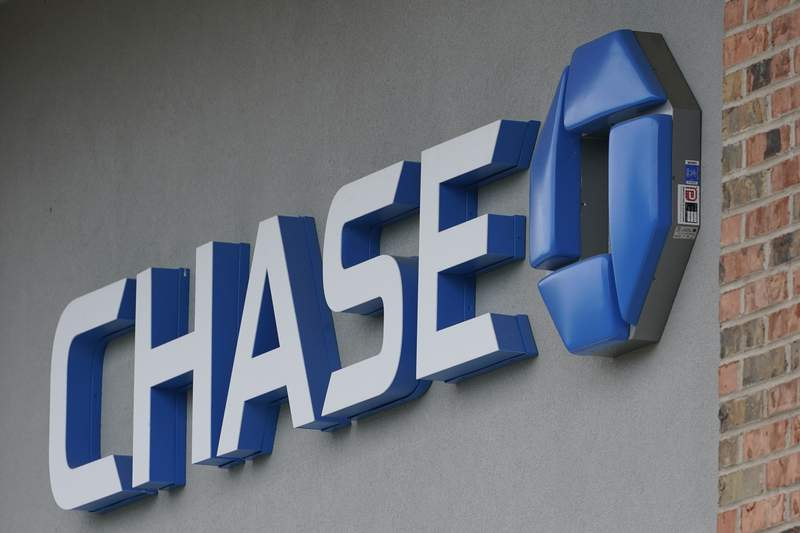 A Chase bank sign in Richmond, Va., Wednesday, June 2, 2021.  JPMorgan Chase reported a 24% increase in net income for the third quarter, Wednesday, Oct. 13, 2021.  (AP Photo/Steve Helber)