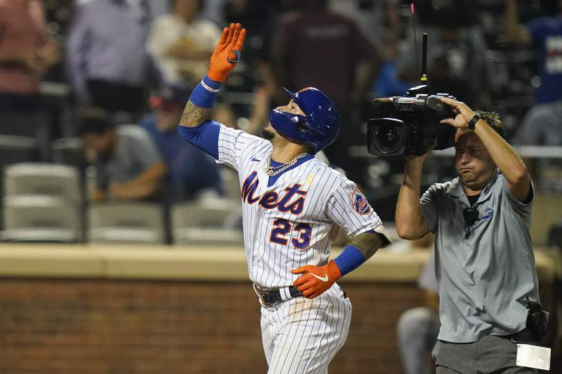 New York Mets' Javier Baez (23) gestures after hitting a home run during the ninth inning of a baseball game against the St. Louis Cardinals Tuesday, Sept. 14, 2021, in New York. (AP Photo/Frank Franklin II)