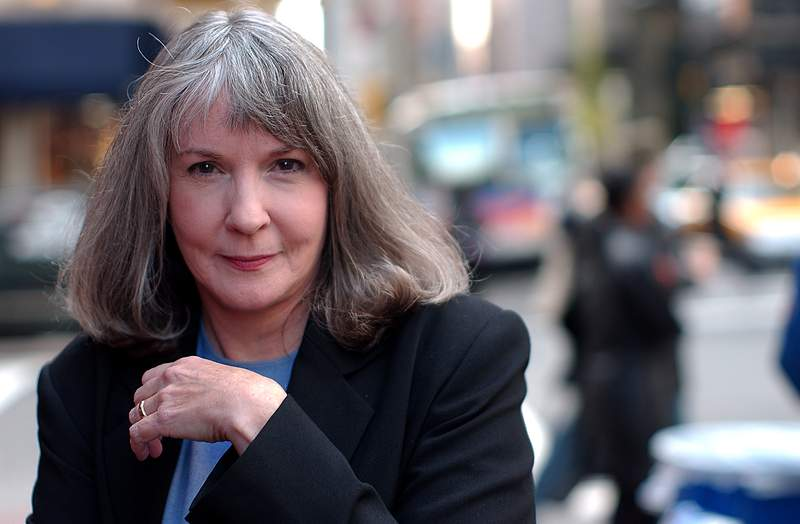 """FILE - Mystery writer Sue Grafton poses for a portrait on Oct. 15, 2002, in New York. A TV adaptation of the late writer's million-selling Kinsey Millhone mystery novels, a prospect the author once swore she would return from the dead to prevent, is now the works. A+E Studios announced this week that it had acquired rights to Grafton's famed alphabet series, with such titles as """"'A' Is for Alibi"""" and """"'E' Is for Evidence."""" (AP Photo/Gino Domenico, File)"""