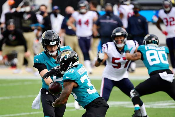 JACKSONVILLE, FLORIDA - NOVEMBER 08:  Jake Luton #6 hands the ball to James Robinson #30 of the Jacksonville Jaguars during the first half against the Houston Texans 2at TIAA Bank Field on November 08, 2020 in Jacksonville, Florida. (Photo by Douglas P. DeFelice/Getty Images)