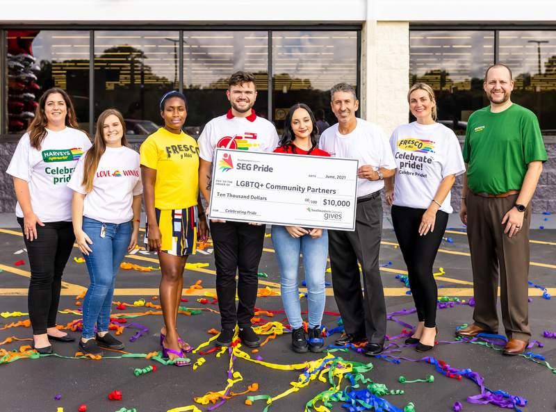Jax PFLAG chapter receives $1,000 donation from Winn-Dixie, Harveys stores