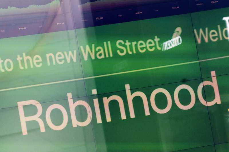 FILE - An electronic screen at Nasdaq displays Robinhood in New York's Times Square following the company's IPO, Thursday, July 29, 2021. Robinhood announced Tuesday, Oct. 5, 2021 that its offering 24/7 phone support for all its customers to cover almost every issue. It follows up on an announcement by Coinbase, which said last month it would launch 24/7 phone service by the end of the year for many customers. (AP Photo/Mark Lennihan, File)