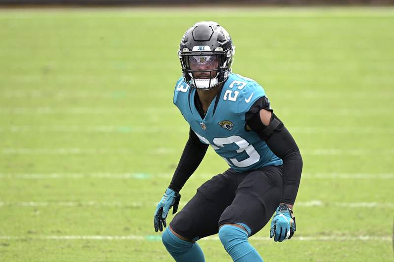 FILE - Jacksonville Jaguars cornerback CJ Henderson (23) follows a play during the second half of an NFL football game against the Houston Texans in Jacksonville, in this Sunday, Nov. 8, 2020, file photo. Henderson hasn't been the same since a shoulder injury last October. New coach Urban Meyer raved about Hendersons rehab in March and said were counting on him. But Meyers faith in Henderson seems to be waning. (AP Photo/Phelan M. Ebenhack, File)