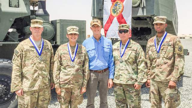 During his visit to Camp Buehring, Gov. Rick Scott awarded four Florida Army Reserve National Guard soldiers with the Governor's Medal of Merit. (Photo courtesy: Governor's Press Office)