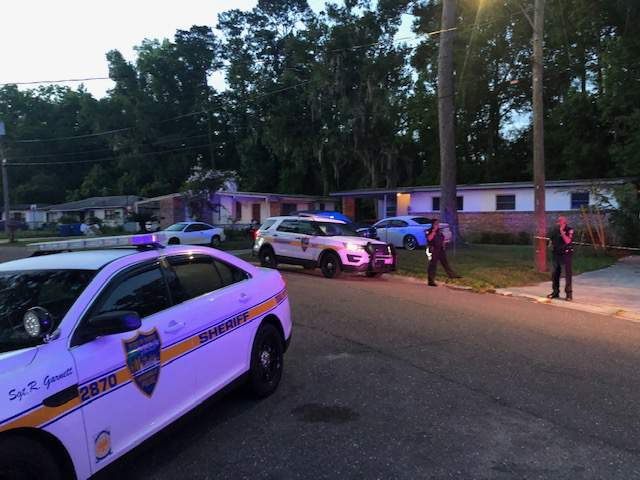 Picture shows officers on scene of a shooting at a home on Carthage Drive in the Northside of Jacksonville.