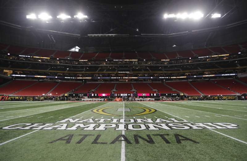 FILE - In this Jan. 8, 2018, file photo, the championship logo is seen on the field at Mercedes-Benz Stadium before the NCAA college football playoff championship game between Georgia and Alabama in Atlanta. (AP Photo/David Goldman)