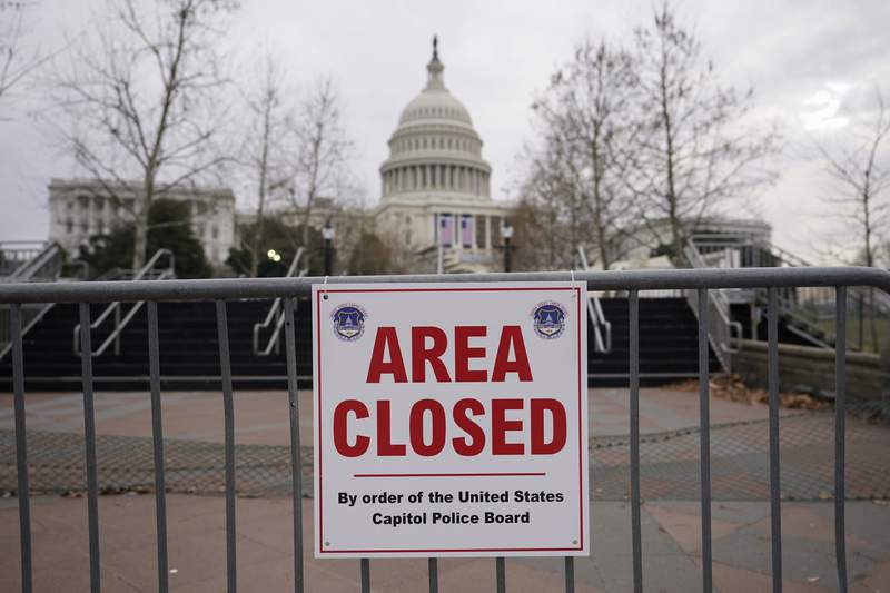 FILE - In this Monday, Jan. 11, 2021, file photo, signs are posted to close the area around the U.S. Capitol ahead of the inauguration of President-elect Joe Biden and Vice President-elect Kamala Harris in Washington. (AP Photo/Carolyn Kaster, File)
