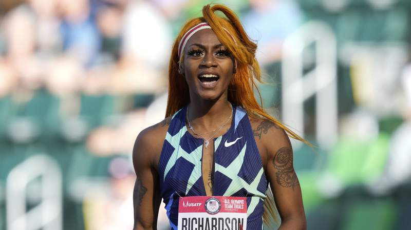 In this June 19, 2021 photo, Sha'Carri Richardson celebrates after winning the first heat of the semis finals in women's 100-meter runat the U.S. Olympic Track and Field Trials in Eugene, Ore.    Richardson cannot run in the Olympic 100-meter race after testing positive for a chemical found in marijuana.  Richardson, who won the 100 at Olympic trials in 10.86 seconds on June 19, told of her ban Friday, July 2 on the Today Show.(AP Photo/Ashley Landis)