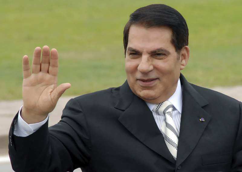 FILE - In this Oct.11, 2009 file photo, then Tunisian President Zine El Abidine Ben Ali waves from his car at a campaign rally in Rades, outside Tunis.  Swiss authorities said Monday Jan. 18, 2021, they are preparing to lift a freeze on tens of millions of dollars worth of assets linked to former Tunisian President Zine El Abidine Ben Ali, who fled with his family to Saudi Arabia in 2011 and died in 2019. (AP Photo/Hassene Dridi, File)