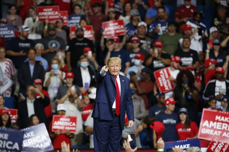 FILE - In this June 20, 2020, file photo, President Donald Trump speaks during a campaign rally at the BOK Center in Tulsa, Okla. The coronavirus pandemic isn't going away anytime soon, but campaigns are still forging ahead with in-person organizing. The pandemic upended elections this year, forcing campaigns to shift their organizing activities almost entirely online and compelling both parties to reconfigure their conventions. (AP Photo/Sue Ogrocki, File)