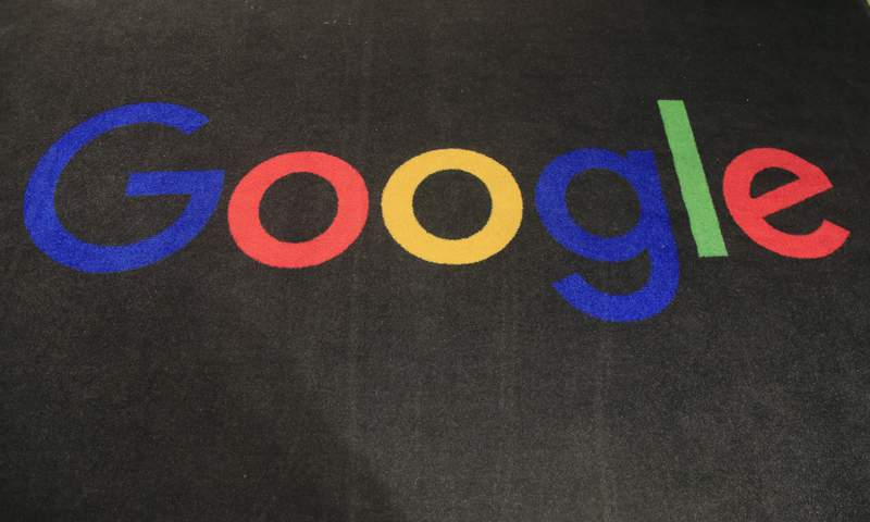 FILE - In this Monday, Nov. 18, 2019, file photo, the logo of Google is displayed on a carpet at the entrance hall of Google France in Paris. In a settlement announced Monday, Feb. 1, 2021, Google will pay $2.6 million to more than 5,500 employees and past job applicants to resolve allegations that the internet giant discriminated against female engineers and Asians in California and Washington state. (AP Photo/Michel Euler, File)