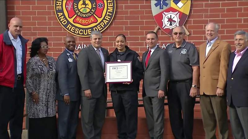 Jacksonville security guard awarded college scholarship for saving firefighter's life