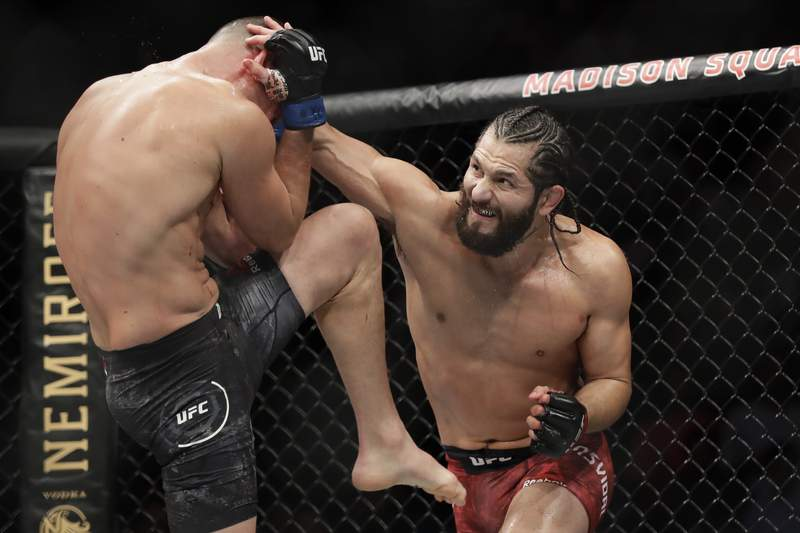 FILE - In this Nov. 3, 2019, file photo, Jorge Masvidal, right, punches Nate Diaz during the second round of a welterweight mixed martial arts bout at UFC 244 in New York. Masvidal had to fly halfway around the world on six days notice to get the first UFC title shot in his 17-year mixed martial arts career. Masvidal is not mad about the twists that sent him to Abu Dhabi this week with minimal time to train for his fight with Kamaru Usman at UFC 251. (AP Photo/Frank Franklin II, File)